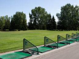 tree lined driving range at The Links at Spruce Grove
