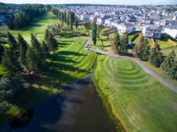 aerial view of fairways, sand bunkers, and water hazard at The Links at Spruce Grove