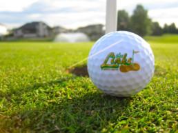 The Links at Spruce Grove golf ball on fresh cut green