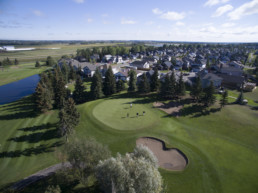 green fairway, putting green and sand bunker at The Links at Spruce Grove