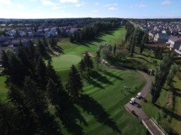 tree lined fairway and well manicured golf greens at The Links at Spruce Grove