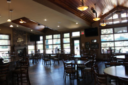 dining room with lots of natural light and a fireplace at The Grill at The Links at Spruce Grove