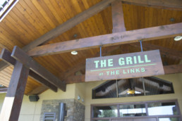 sign outside of The Grill at The Links at Spruce Grove