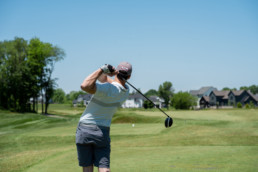 gofler drive swing off the tee box at The Links at Spruce Grove